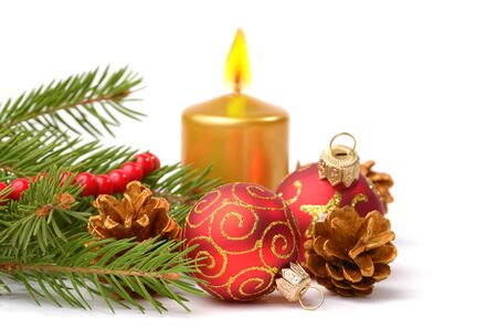 Christmas balls with gold candle over white Stock Photo - 11294518