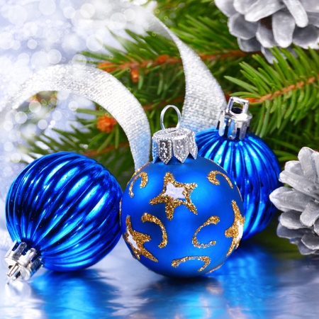 Blue and silver Christmas balls over bright background