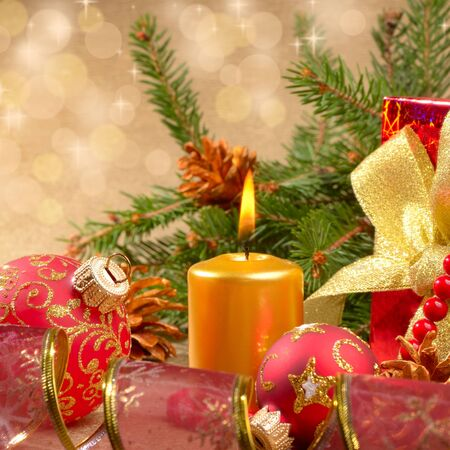 Christmas tree decorations with gift box over golden background Stock Photo - 11294525