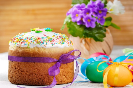 Easter eggs and cake on the bright background