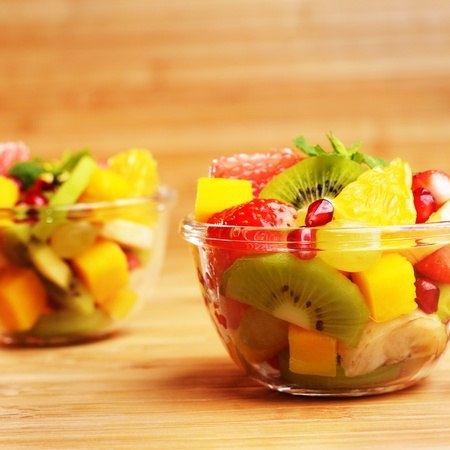 Healthy fruit salads on the kitchen table photo
