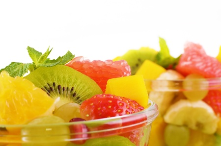 Healthy fruit salad over white background closeup photo