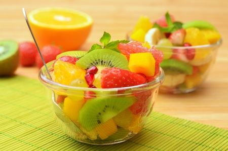 Fruit mix salad on the table photo
