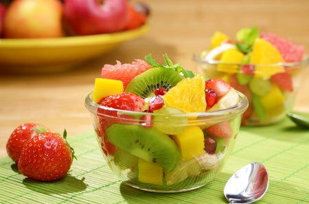 sliced orange: Healthy fruit salad in the glass bowl Stock Photo