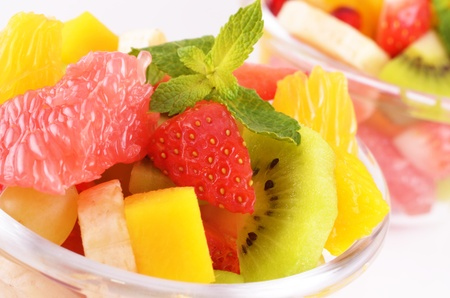 Healthy fruit salad in the glass bowl photo