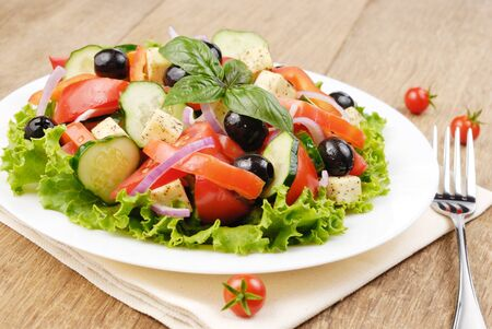Greek salad on the white plate photo
