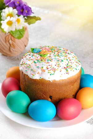 Easter eggs and cake on the bright background photo