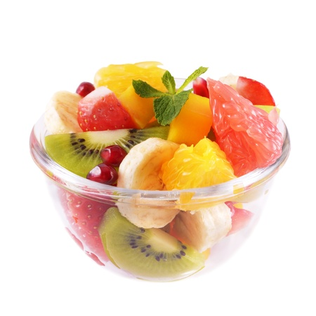 fresh fruits: Healthy fruit salad in the glass bowl over white background Stock Photo