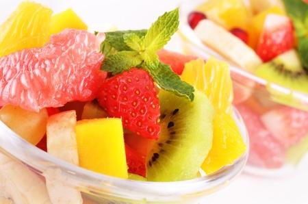 mix fruit: Healthy fruit salad over white