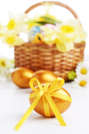 Easter eggs with bows over white background photo