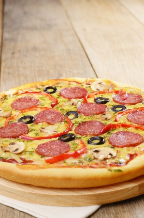 pepperoni pizza: Pepperoni pizza with mushrooms and peppers