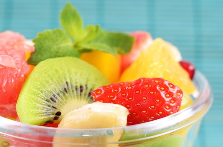Healthy fruit salad in the glass bowl Stock Photo - 13052378