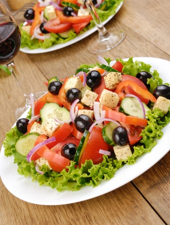 Vegetable salad and glass of red wine on the oak table Stock Photo - 13141865
