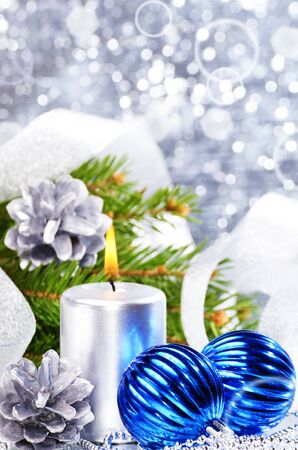 Blue Christmas balls with silver candle over bright background Stock Photo - 13168554