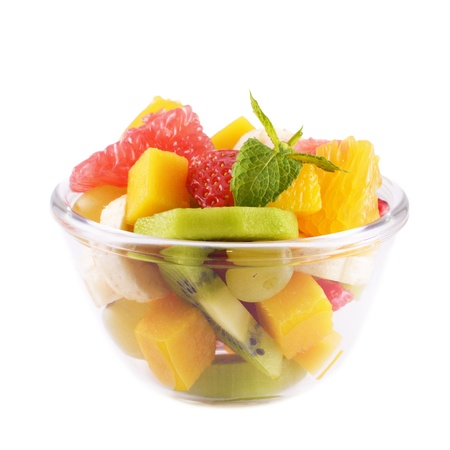 Healthy fruit salad in the glass bowl over white background photo