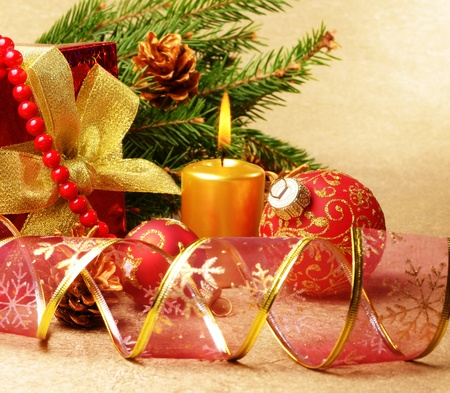 Christmas decorations with gift box over golden background photo
