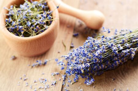 Pestle and mortar with lavender on the oak table  Stock Photo - 14371158