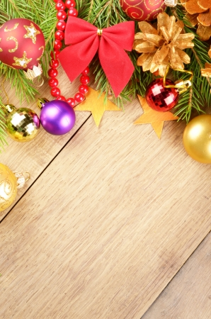 Christmas background with balls and decorations over wooden table photo