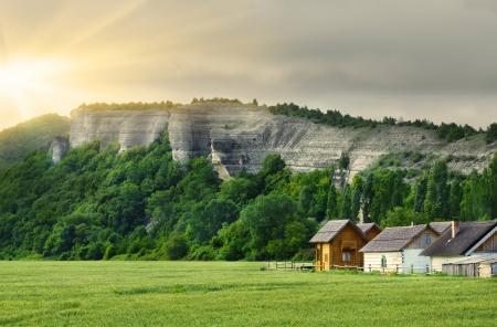 farm home: Farm house under mountain