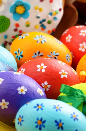 Painted easter eggs with bows background photo
