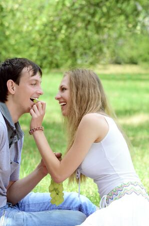 Young happy couple in love at picnic outdoors photo