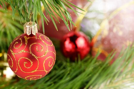 glass christmas tree ornament: Christmas red ball over bright background Stock Photo