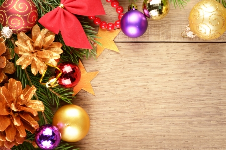 christmas backgrounds: Christmas background with balls and decorations over wooden table