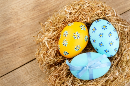 Nest with Easter eggs on the wooden table Stock Photo - 15233994