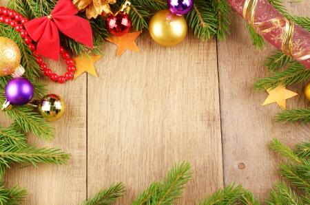 Christmas background with balls and decorations over wooden table copy-space