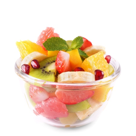 Healthy fruit salad in the glass bowl isolated on white Reklamní fotografie