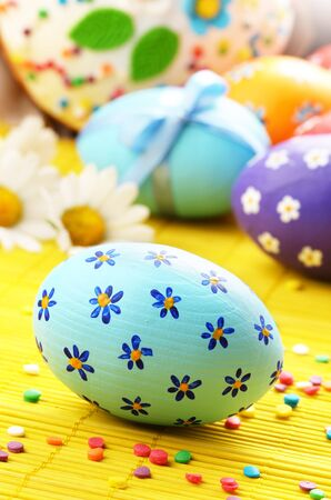 Easter decorations - eggs with painted flowers on the tabletop photo