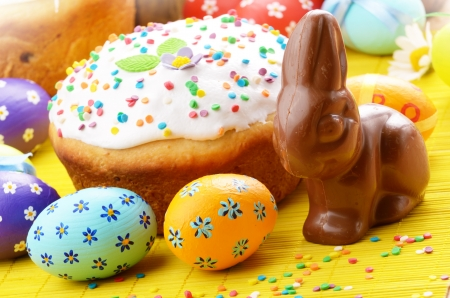 Easter eggs, cake and bunny shape chocolate photo