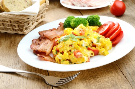 Omelet with vegetables, fried bacon and brad Stock Photo - 15865897