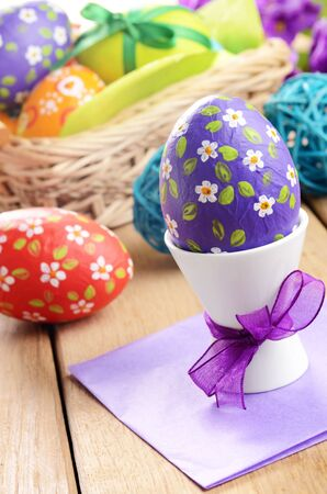Hand crafted easter eggs with wicker basket Stock Photo - 15995437
