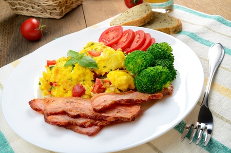 Omelet with fried bacon on the white plate photo