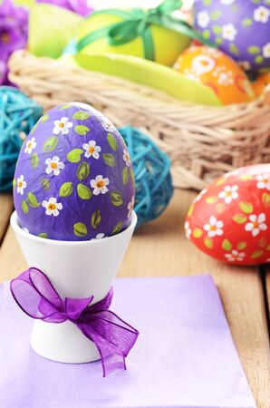 Hand crafted easter eggs with wicker basket Stock Photo - 16241042