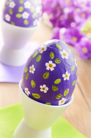 Hand crafted easter eggs on the wooden table photo