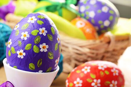 Hand crafted easter eggs in wicker basket Stock Photo - 16525882