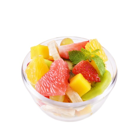mango fruit: Glass bowl with mixed fruit salad over white background Stock Photo
