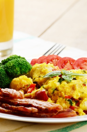 bacon and eggs: Omelet with vegetables, fried bacon and orange juice