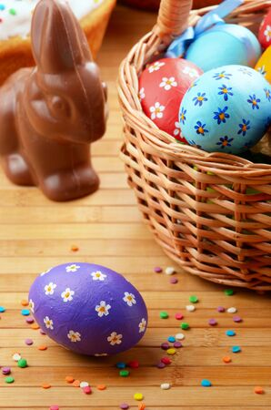 Easter eggs, cake, basket and chocolate bunny photo
