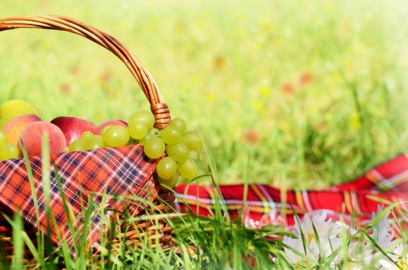 Picnic basket with red napkin fool of fruits Stock Photo