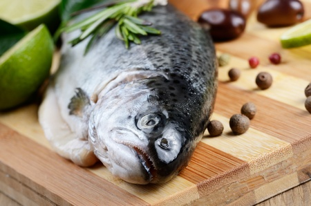 Raw trout on the chopping board with lime and spices Stock Photo - 18656368