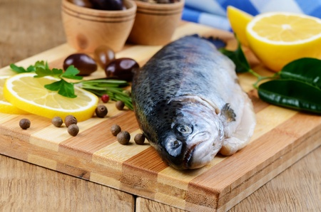 Raw trout on the chopping board with lemon and spices Stock Photo - 18901942