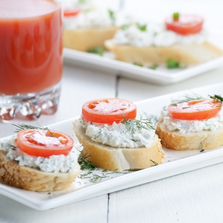 Breakfast of cottage cheese sandwiches on white table photo