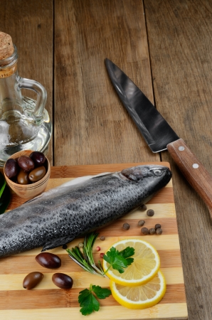 Raw trout on the chopping board with lemon and spices Stock Photo - 20228062