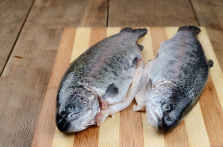 Two raw trout set on the kitchen table Stock Photo - 20380562