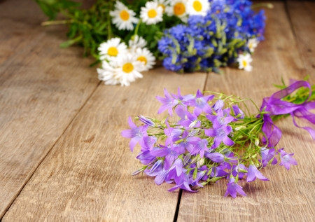 Campanula flowers closeup on the wooden table photo