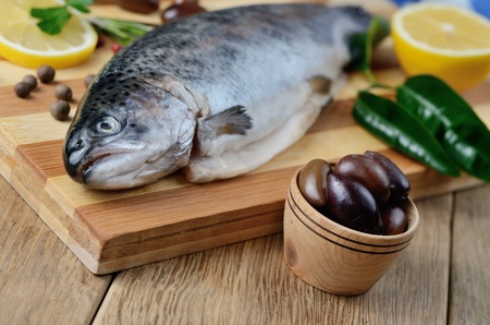 Raw trout on the chopping board with lemon and spices Stock Photo - 20498350
