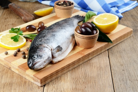 Raw trout on the chopping board with lemon and spices Stock Photo - 20694807